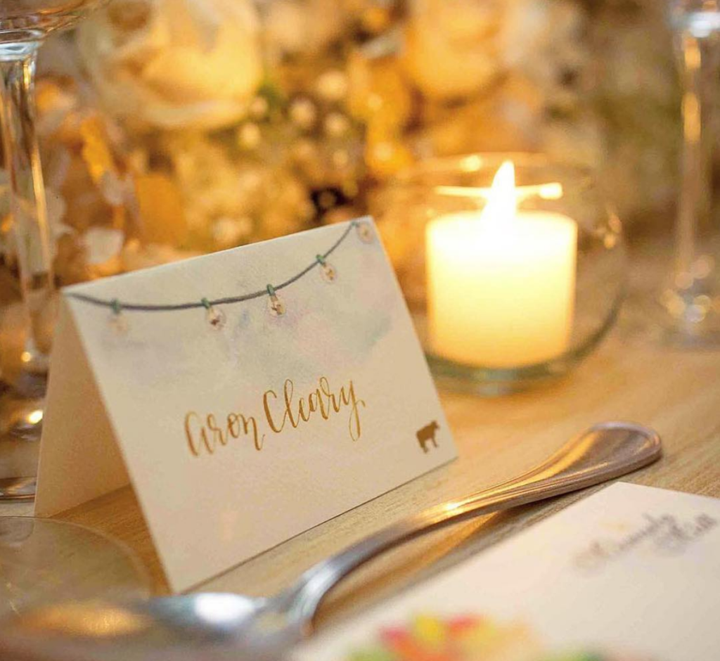 Photo by MAT Fotografia. Placecard and menu design by Handpainted Weddings.